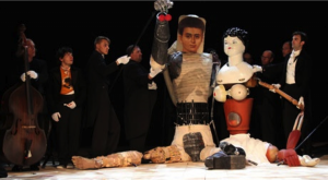 "Figure 1. Rude mechanicals with Pyramus and Thisbe in Dmitry Krymov's ""Midsummer Night's Dream (As You Like It)"" (2012). Photograph by Natalia Cheban. Used by permission of Dmitry Krymov Lab."