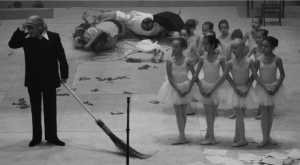 "Figure 3. Stagekeeper with little ballerinas in Dmitry Krymov's ""Midsummer Night's Dream (As You Like It)"" (2012). Photograph by Natalia Cheban. Used by permission of Dmitry Krymov Lab."