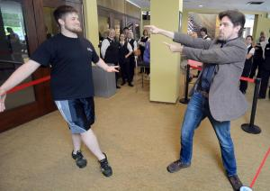 "Figure 1. Users of ""Play the Knave"" in the Stratford Festival Theatre lobby. Photo by Scott Wishart, courtesy of The Stratford Beacon Herald."