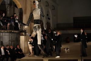 "Figure 2. Pyramus interacts with playgoers (plus dog) in Dmitry Krymov's ""Midsummer Night's Dream (As You Like It)"" (2012). Photograph by Natalia Cheban Used by permission of Dmitry Krymov Lab."