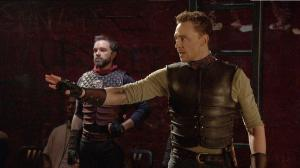 """Figure 2. Martius sins in envying the nobility of Aufidius (1.1). Cinemacast still from the Donmar Warehouse's """"Coriolanus,"""" stage direction by Josie Rourke, screen direction by Tim van Someren, broadcast by National Theatre Live (30 January 2014). Photograph courtesy of Tim van Someren."""