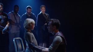 "Figure 3. Coriolanus reunited with his son and wife (5.3). Cinemacast still from the Donmar Warehouse's ""Coriolanus,"" stage direction by Josie Rourke, screen direction by Tim van Someren, broadcast by National Theatre Live (30 January 2014). Photograph courtesy of Tim van Someren."