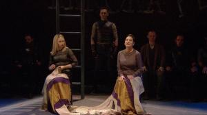"Figure 6. Martius poised between Virgilia and Volumnia (1.3). Cinemacast still from the Donmar Warehouse's ""Coriolanus,"" stage direction by Josie Rourke, screen direction by Tim van Someren, broadcast by National Theatre Live (30 January 2014). Photograph courtesy of Tim van Someren."