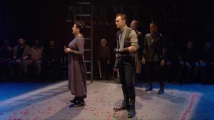 "Figure 7. Young Martius positioned between Coriolanus and his mother (3.2). Cinemacast still from the Donmar Warehouse's ""Coriolanus,"" stage direction by Josie Rourke, screen direction by Tim van Someren, broadcast by National Theatre Live (30 January 2014). Photograph courtesy of Tim van Someren."