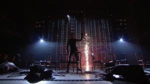 """Figure 9. Martius towers over his troops at Corioles (1.4). Cinemacast still from the Donmar Warehouse's """"Coriolanus,"""" stage direction by Josie Rourke, screen direction by Tim van Someren, broadcast by National Theatre Live (30 January 2014). Photograph courtesy of Tim van Someren."""